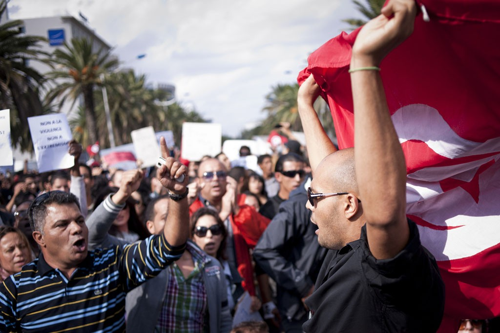Tunisians demonstrate for peace, freedom of speech and for a secular state.