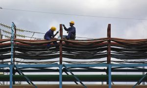 Workers maintain the thermal power station at Takoradi, Ghana