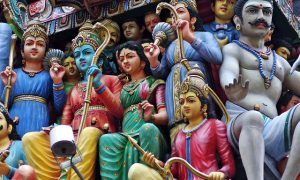 Many colourful figures of Hindu gods are shown